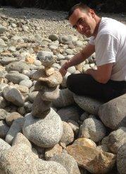 stone balancing son at Cala Pedrosa